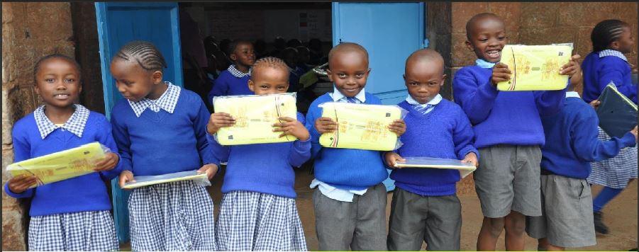 school children receiving eaglegroup edutabs